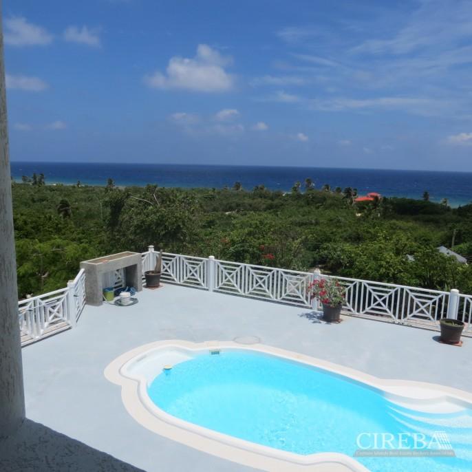 CAYMAN BRAC GUEST HOUSE PLUS BEACH FRONT LOT - Image 1