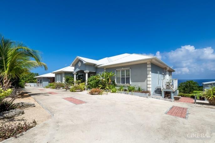 CAYMAN BRAC GUEST HOUSE PLUS BEACH FRONT LOT - Image 9