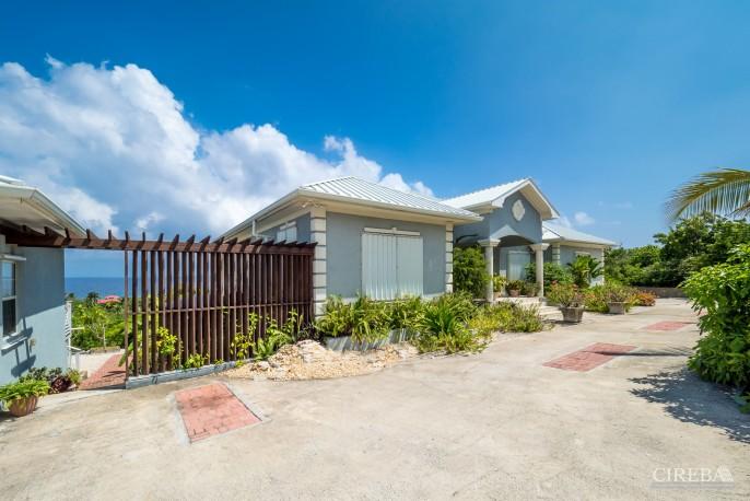 CAYMAN BRAC GUEST HOUSE PLUS BEACH FRONT LOT - Image 10