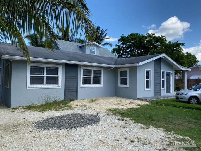 NORTH SOUND ESTATES  HOME WITH INCOME  PRODUCING APARTMENTS